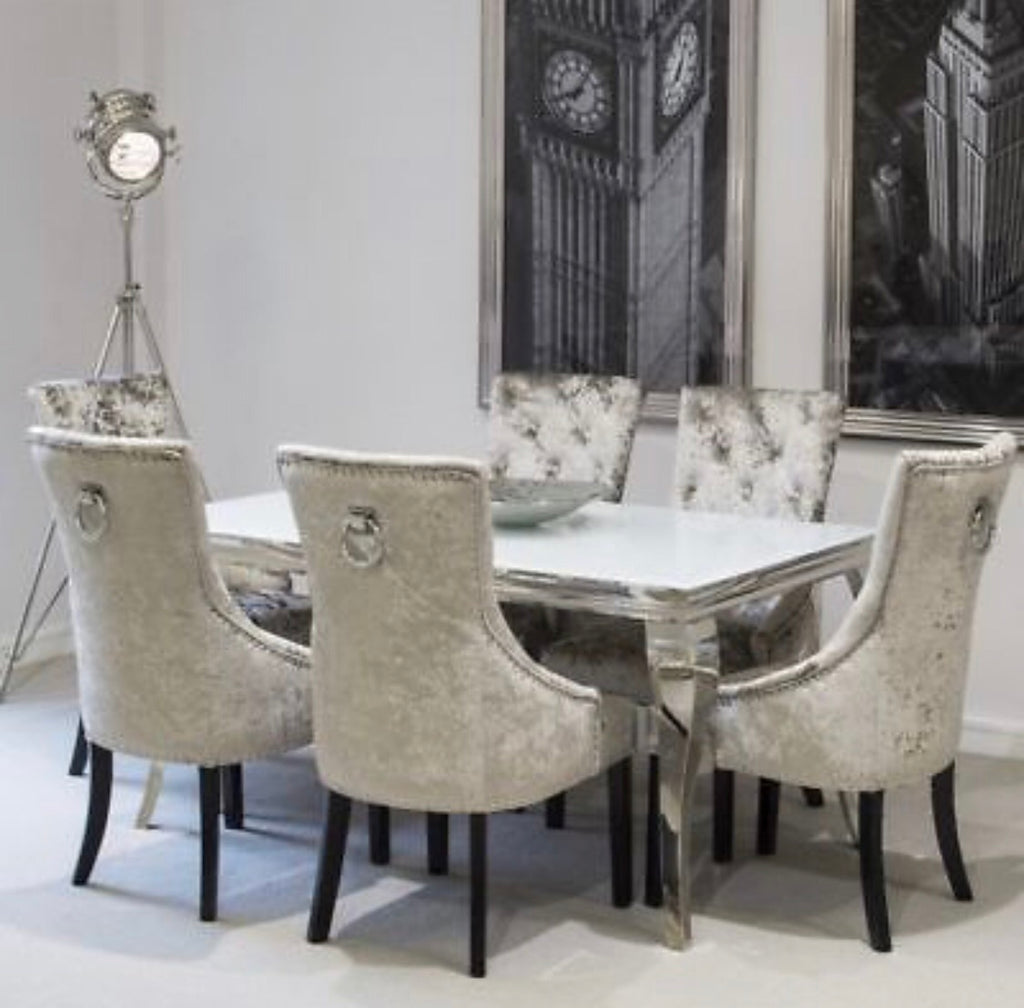 Louis mirrored dining set with 6 knockerback chairs.