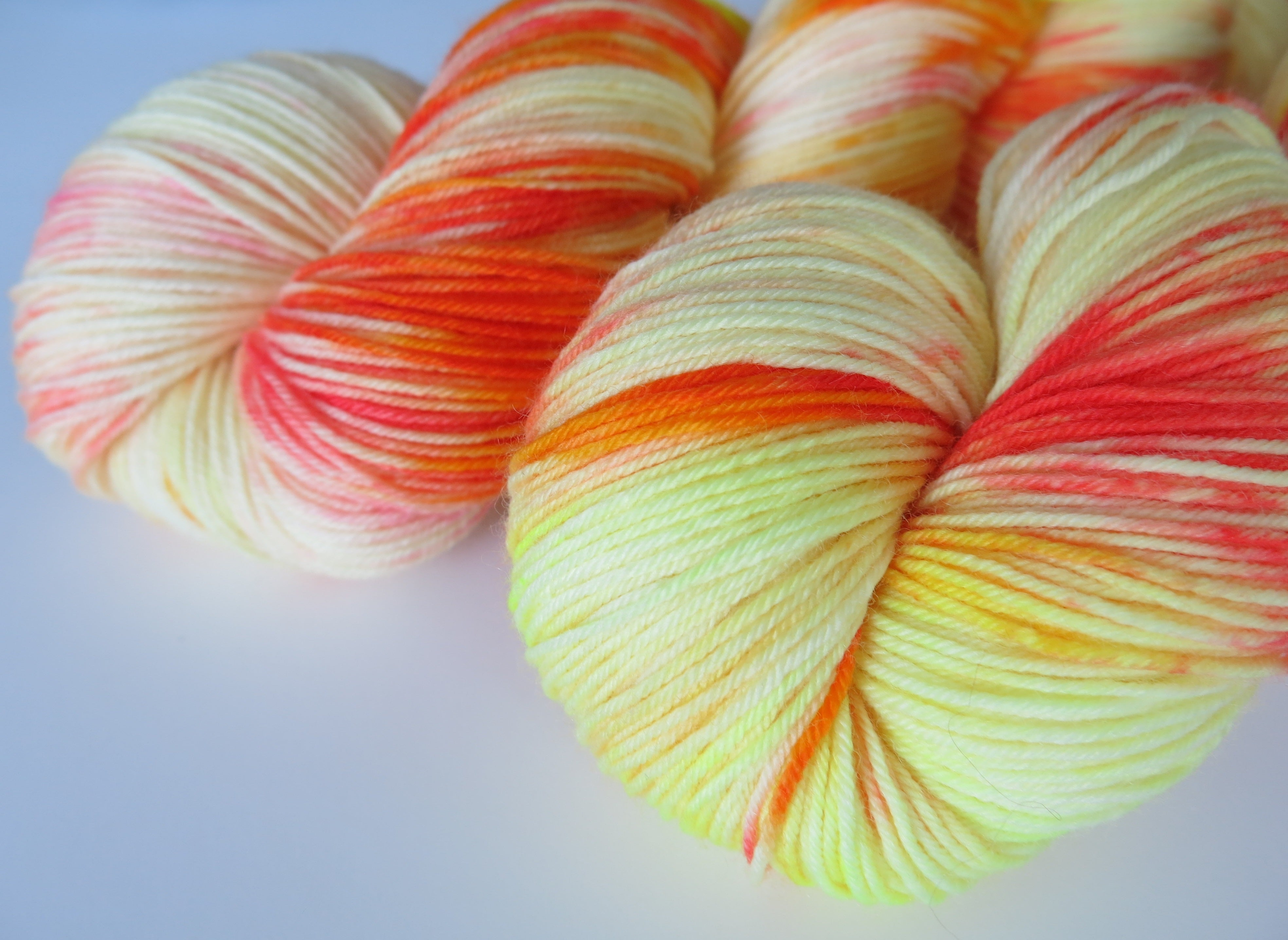 hand dyed orange and yerllow merino sock yarn skein