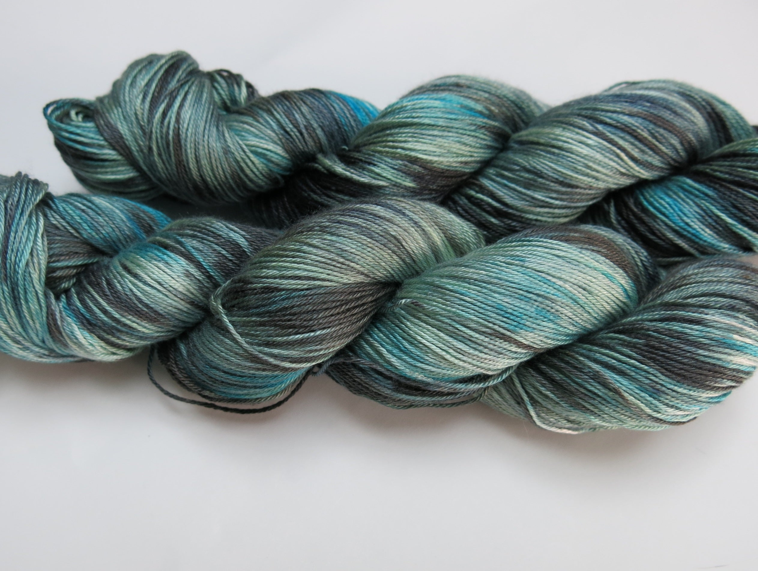 blue and black hand dyed mulberry silk sock weight yarn