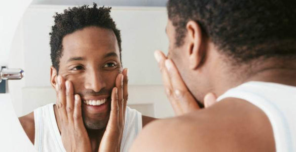 man looking mirror clear skin chin acne|||man washing face cleanse|men clear skin acne|