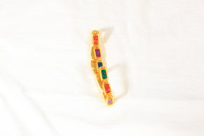 Gold toned bracelet containing multicolored stones