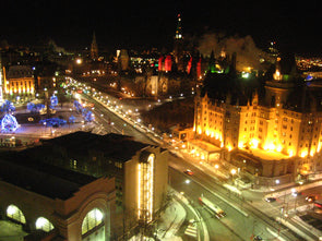 christmas lights in ottawa showcasing the chateau laurier, the war memorial and parliament hill