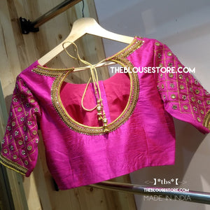 Simple and elegant handcrafted saree blouse in pink - Indian Saree Blouse Design 166