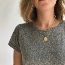 Load image into Gallery viewer, Custom Gold Disc Necklace. Made by Erin Bess Jewelry. Personalize this simple gold disc necklace with a name, word or monogram. This simple gold disk necklace will be the one you reach for every morning. Made of 14K gold, this minimal necklace will be beautiful for years to come.