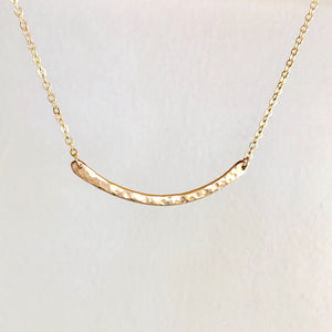 Minimal Gold Hammered Bar Necklace. This curved hammered bar necklace, or gold crescent bar necklace,  is hand-crafted by Erin Bess in Indiana. The minimalist style necklace necklace will quickly be the one you reach for everyday. The simple hammered bar necklace adds the perfect amount of sparkle to everyday outfits.
