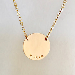 Custom Gold Disc Necklace. Made by Erin Bess Jewelry. Personalize this simple gold disc necklace with a name, word or monogram. This simple gold disk necklace will be the one you reach for every morning. Made of 14K gold, this minimal necklace will be beautiful for years to come.