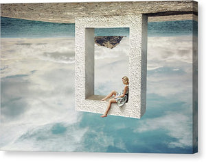 Young woman sitting in the stone frame upside down
