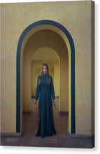 Load image into Gallery viewer, Young woman in blue long dress standing with the knife in the arch passage.