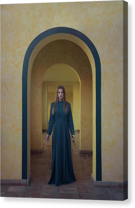 Young woman in blue long dress standing with the knife in the arch passage.