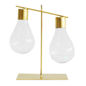 Light Bulb on Gold Stand