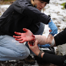 Load image into Gallery viewer, Going beyond bleeding control and learning proper wound management is an important skill taught in a Wilderness First Responder (WFR) course.