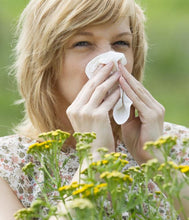 Woman with allergies near flowers