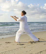 Chi Kung (Qi Gong) practitioner practising on beach