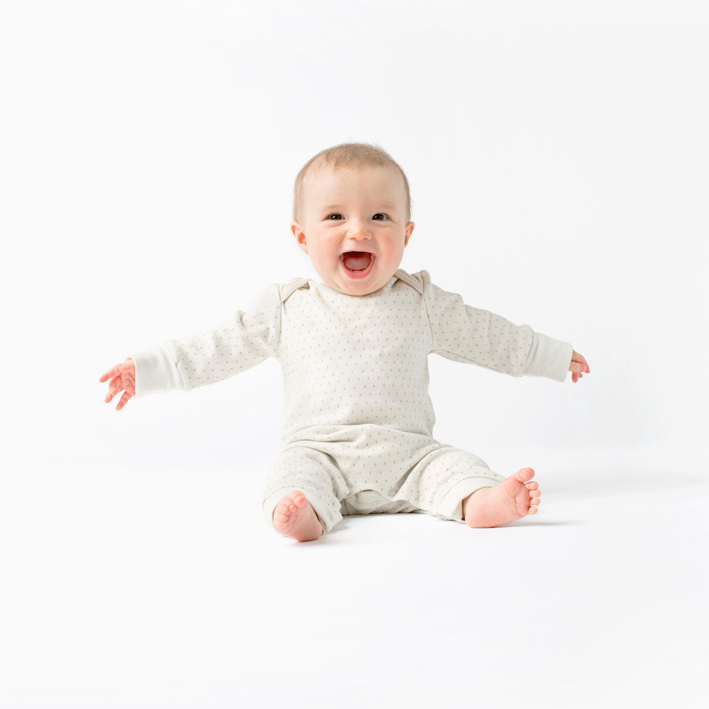 French Grey Kisses Baby Grow with poppers along legs. Made From 100% Organic Cotton. Cute Baby Image on White Background
