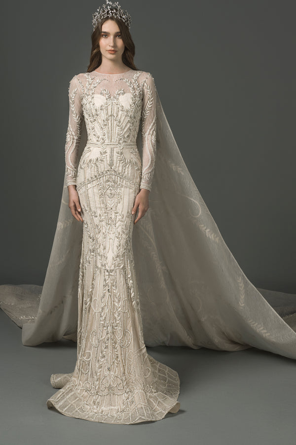 Long-sleeved dress with a long cape.