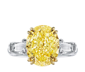 Oval Cut Fancy Yellow Diamond with Baguettes Ring