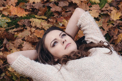 girl laying on leaves