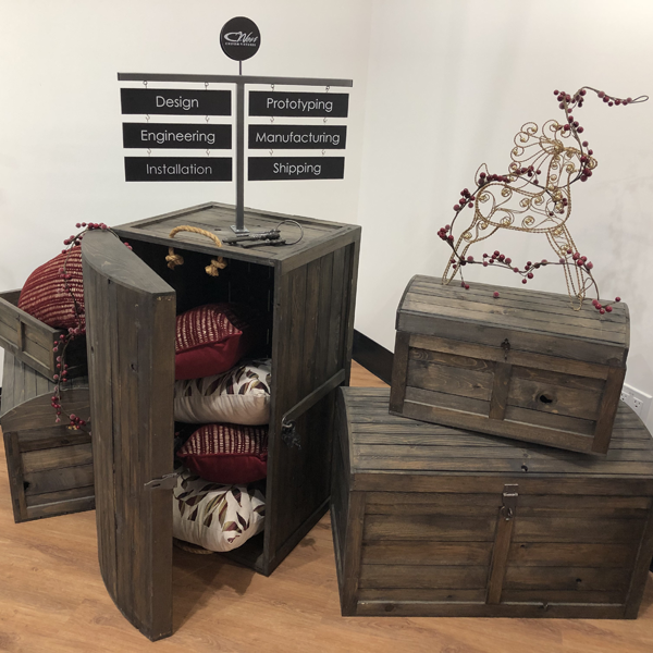 the rustic crate series 300 set up with the T sign holder for a Christmas holiday retail display. They are displaying pillows and a gold wire frame deer