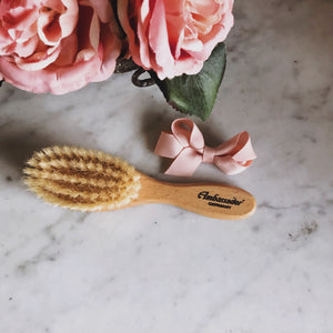 This wood baby brush is made from non-endangered woods and contains boar bristles sheared humanely from farm-raised animals. Packaged in cardboard.