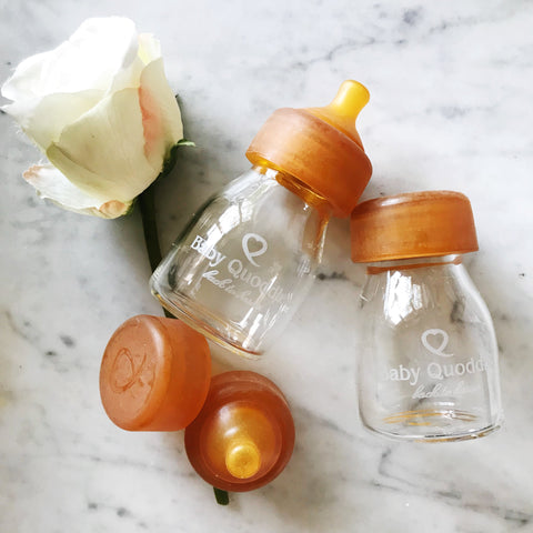 Baby Quoddle glass baby bottles with natural rubber nipples in the mini size.