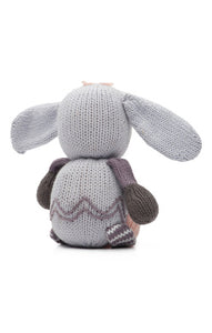 The Finn + Emma Rabbit Rattle Buddy is made from organic GOTs certified cotton and stuffed with sheep's wool. Eco-friendly inks and dyes and fair-trade.