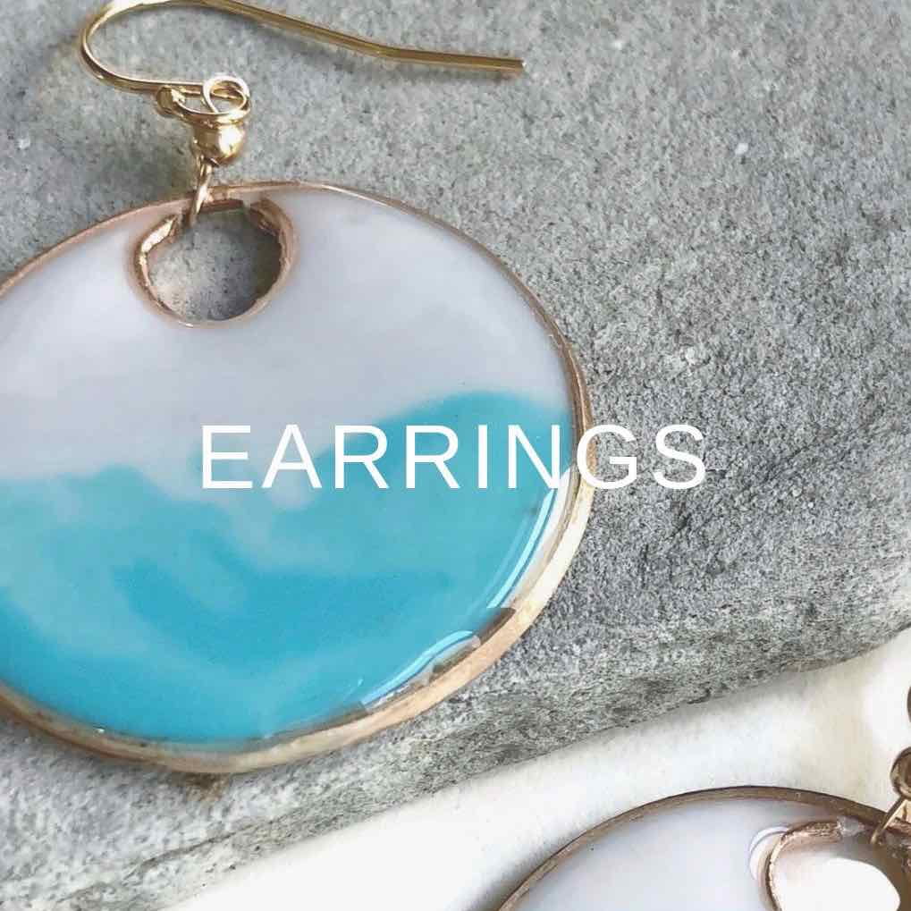 Earrings by Carla De La Cruz Jewelry