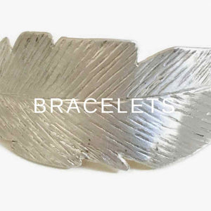 Bracelets  by Carla De La Cruz Jewelry