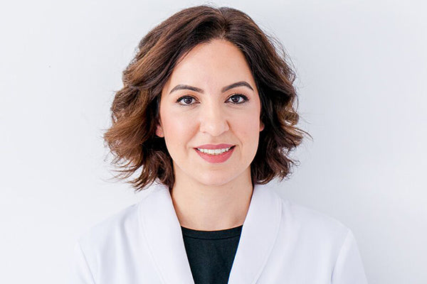 An image of Doctor Heidi Goodarzi in her white coat up against a white background.