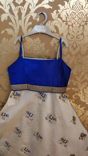 Off White Bhagalpuri Silk With Elephant Print All Over Skirt And Royal Blue Strap Blouse.