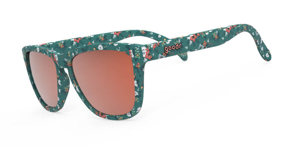 Side view of green framed sunglasses with all over flower print and polarized burnt orange UV protection mirrored lenses
