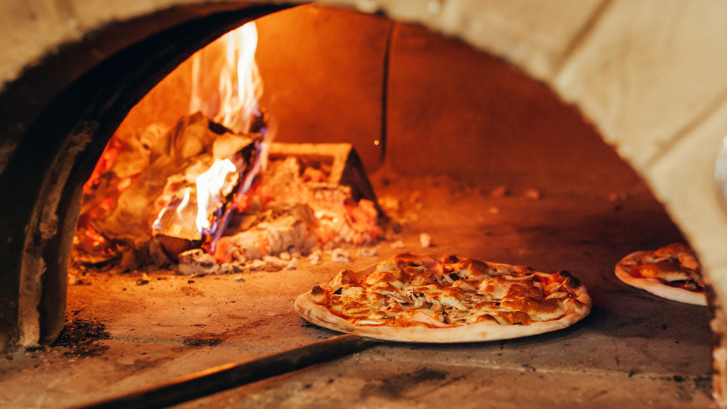 WOOD FIRE STONE OVEN WITH PIZZA COOKING