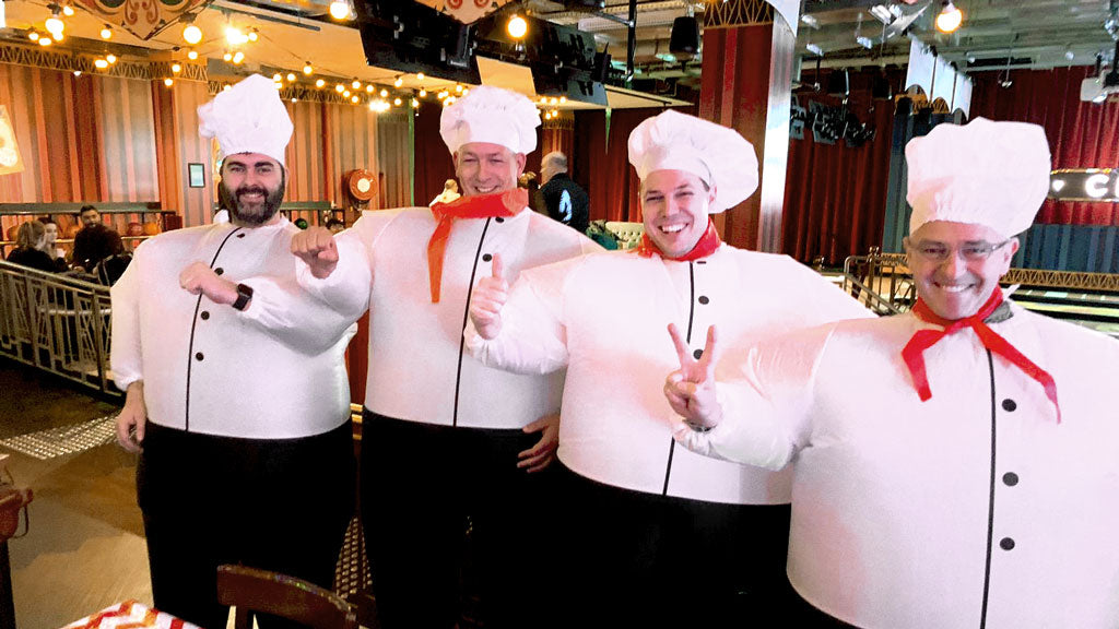 MEN DRESSED IN BLOWN UP CHEF SUITS