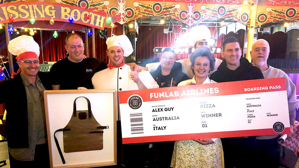 PIZZA COMP WINNERS AND TEAM WITH FLIGHT TICKET