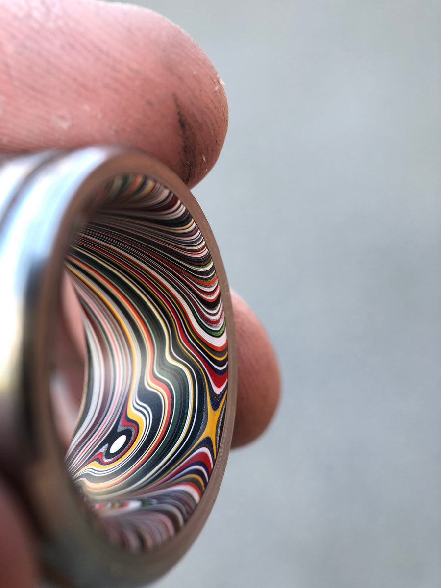 Fordite and titanium Black Badger ring