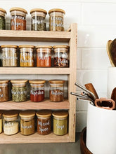 Load image into Gallery viewer, a close up of the spice rack with Little Label Co jars and labels filled with herbs and spices.