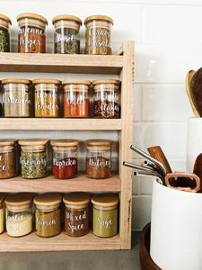 a close up of the spice rack with Little Label Co jars and labels filled with herbs and spices.