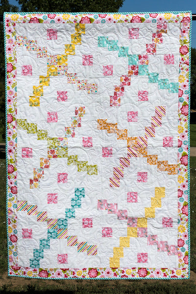 Whirlybird- scrappy baby quilt version in pinks