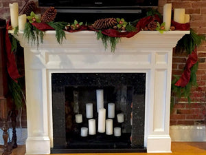 Christmas Fireplace Decorated with Ribbon and Pinecones and Candles