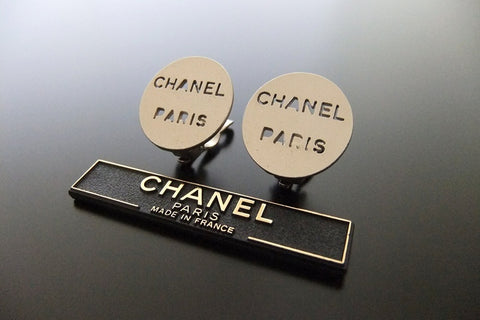 Authentic vintage Chanel earrings metallic color logo