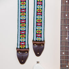 Featured photo of the geometric jacquard that makes our vintage guitar strap in Rhododendron Ave