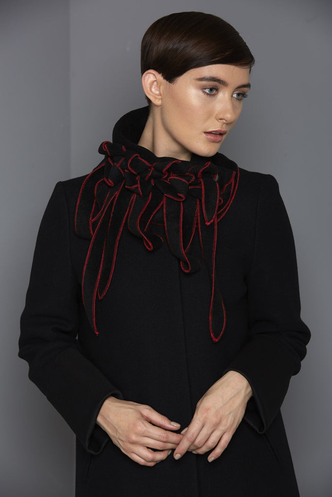 black scarf with red stitching