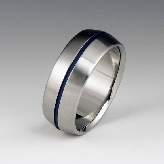 Peaked Profile Titanium Wedding Ring With Blue Pinstripe