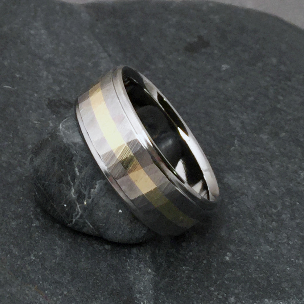 "Beautifully handcrafted titanium wedding band from Classic Titanium. Inlaid with one centered 18k gold stripe. Faceted with our original ""Wood Grain Sequoia"" finish."