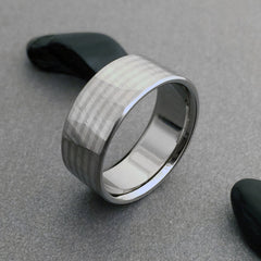 "Beautiful hand ground ""Wood Grain Sequoia"" finished titanium ring in a flat profile, with four narrow 18k white gold pinstripes."