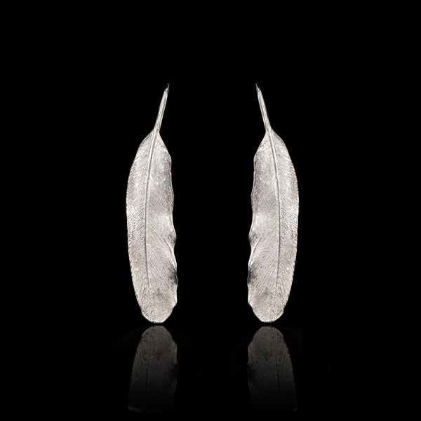 Solid sterling silver Feather Pendant Earrings by British jewellery designer Catherine Zoraida