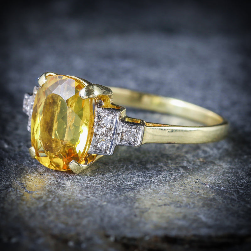 YELLOW BERYL AND DIAMOND TRILOGY RING 18CT GOLD ENGAGEMENT SIDE