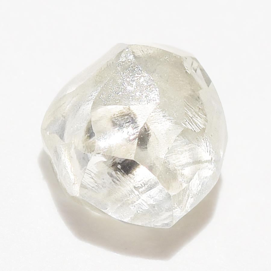 0.57 carat light and clear raw diamond rhombododecahedron