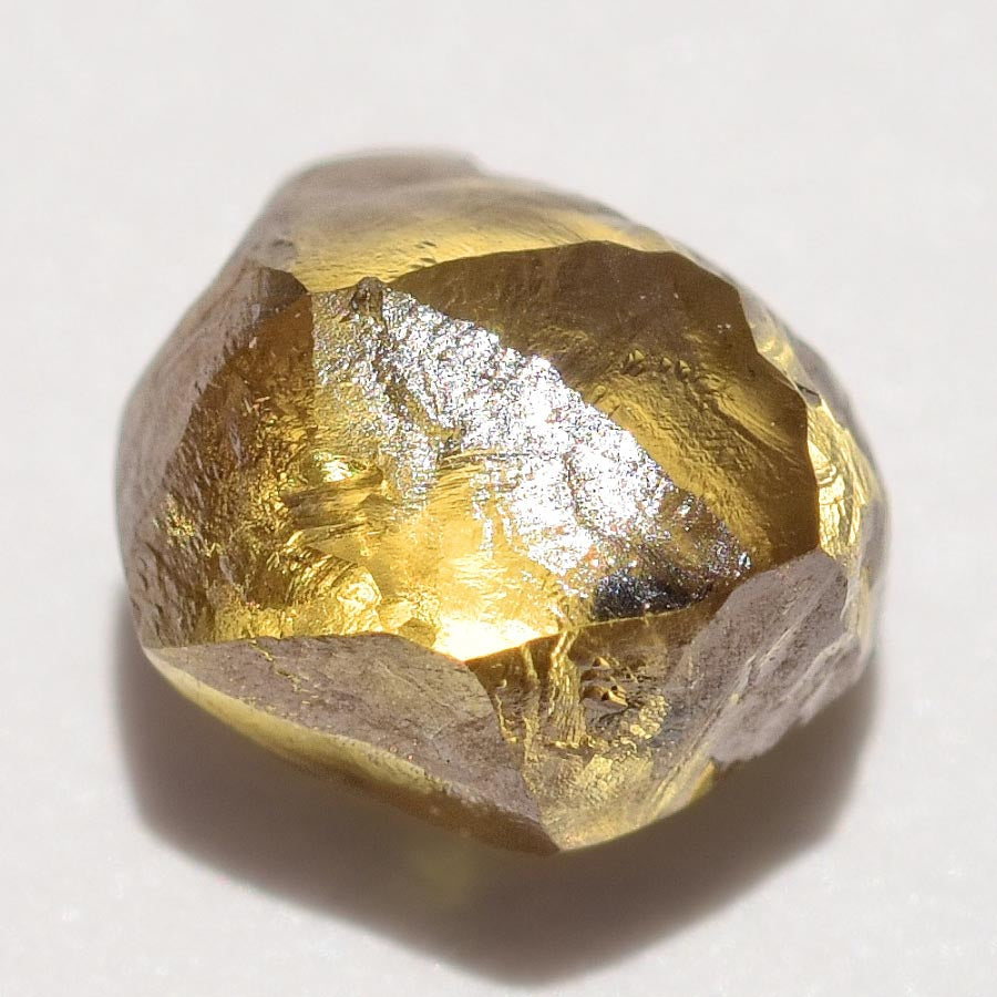 0.67 carat glowy and olive colored freeform rough diamond