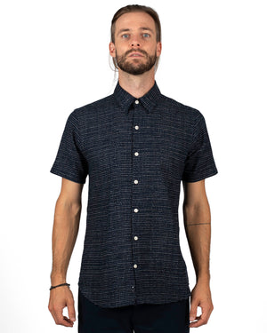 Short Sleeve Navy Men's button up shirt with a subtle white spot pattern - front