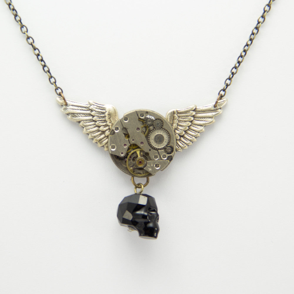 Silver Winged Necklace w/ Crystal Skull